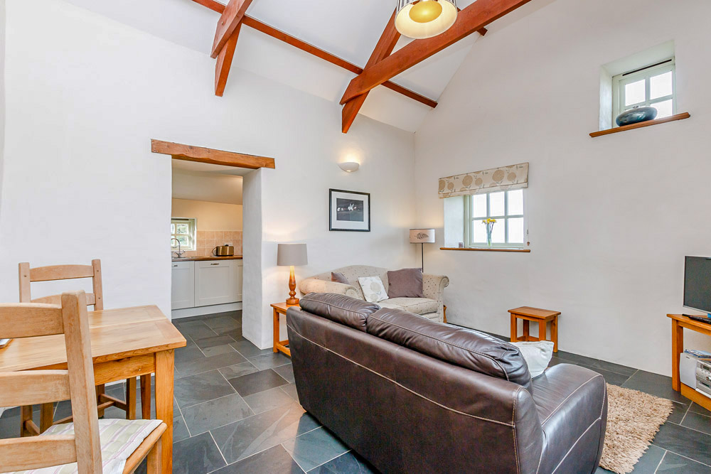 Pencaer Self Catering Cottage lounge with sea views