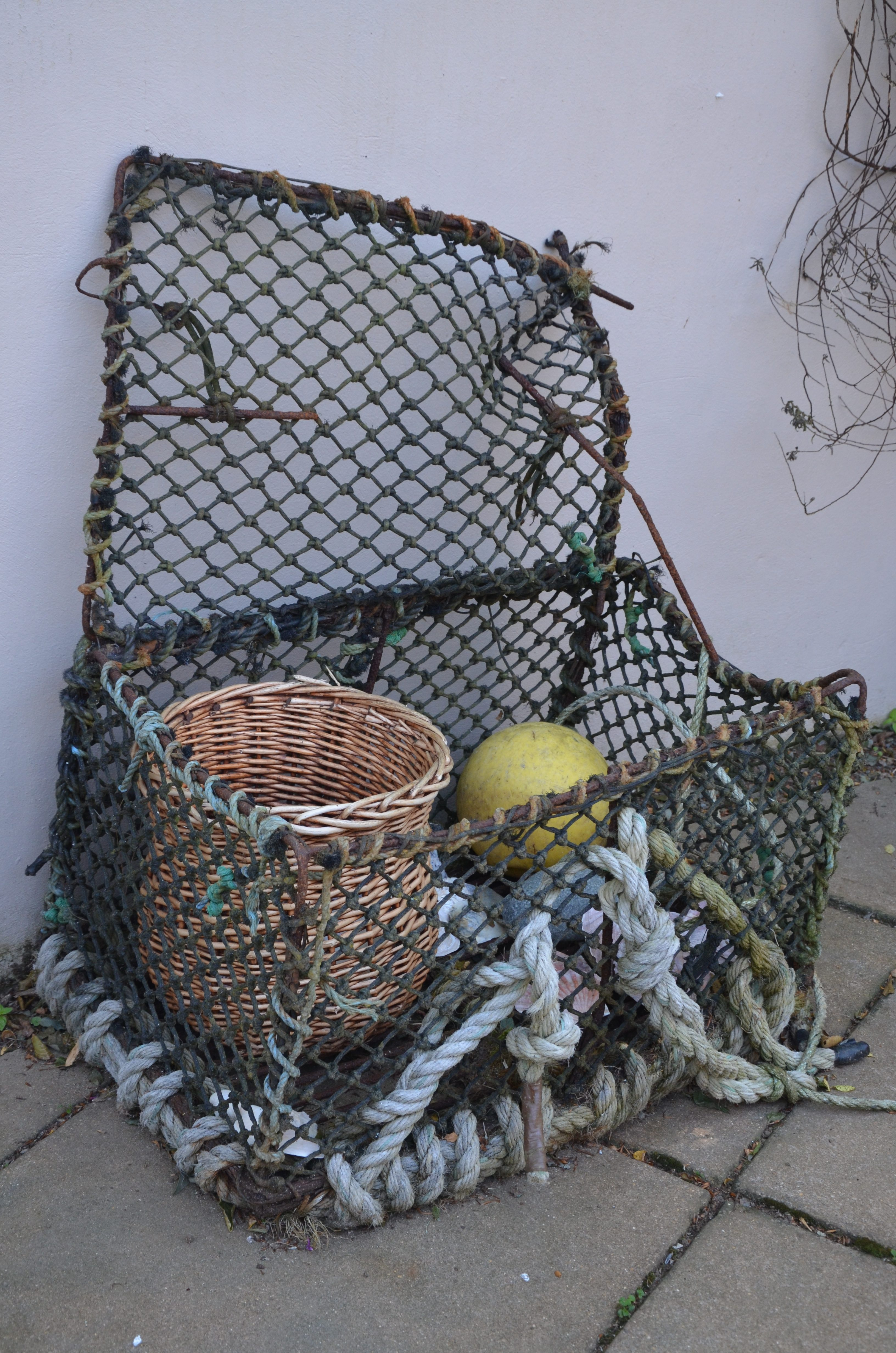 Yr Hafan access to guest rooms through pretty courtyard garden and patio area complete with old Lobster Pot