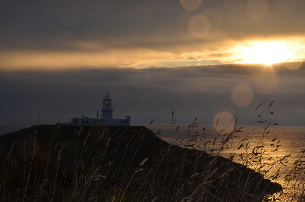 Strumble Head light house at dusk from the coast path