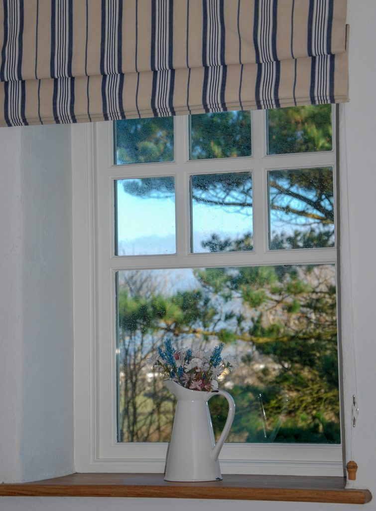 Yr Hafan- Penberi Self Catering Cottage with sea views from bedroom