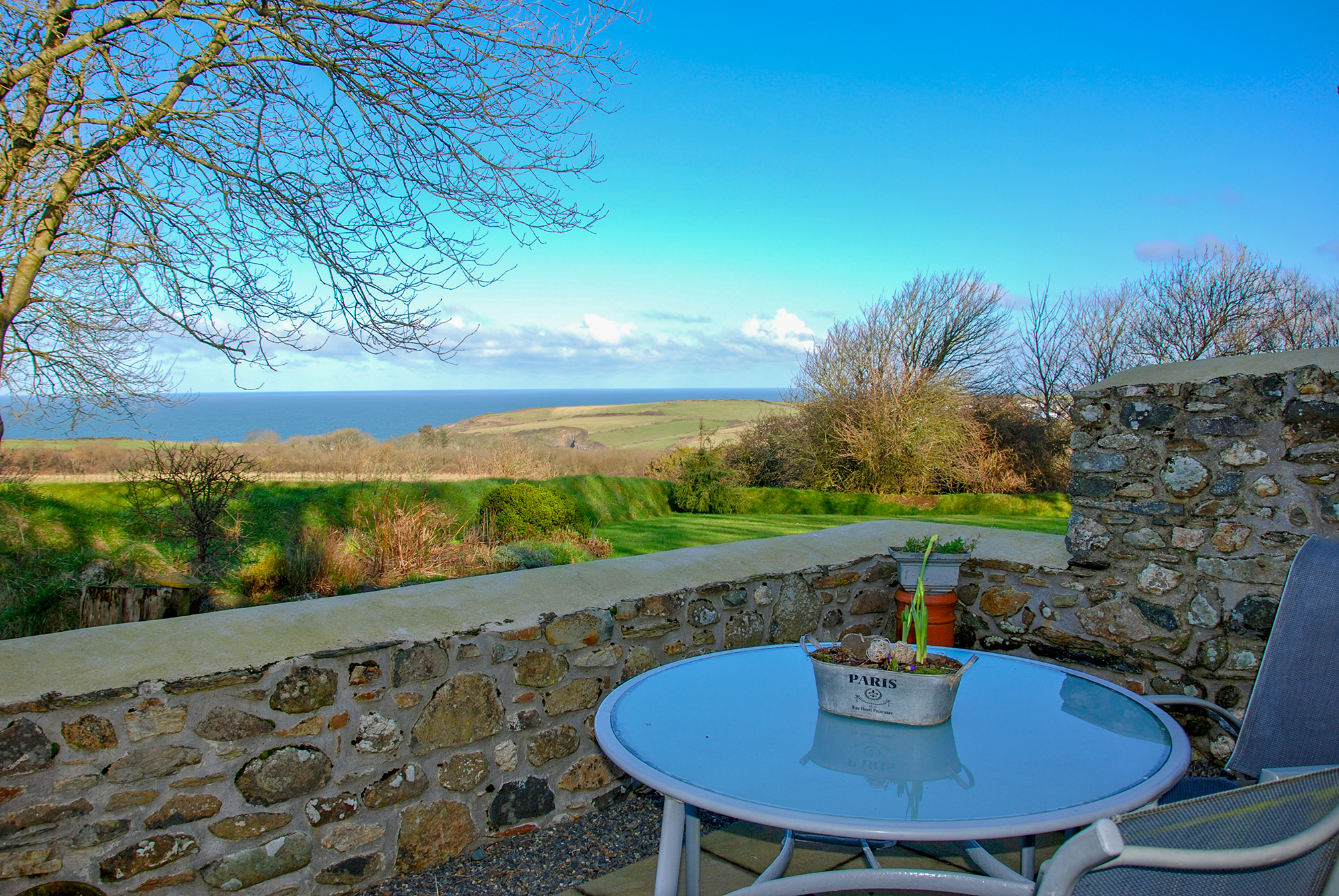 Yr Hafan - Penberi Self Catering Cottage sunny private patio with sea views