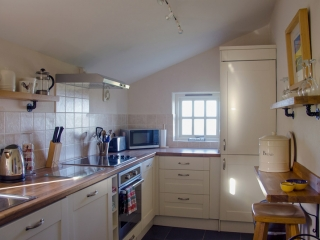 Yr Hafan Pencaer Self Catering Cottage kitchen with sea views
