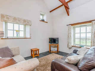 Pencaer Self Catering Cottage -double aspect lounge with sea views